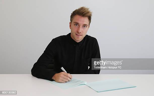 Christian Eriksen of Tottenham Hotspur poses while signing a new contract at the Tottenham Hotspur Training Ground on September 6 2016 in Enfield...