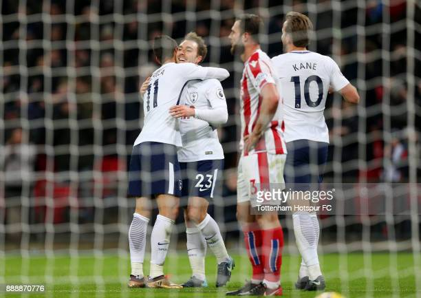 Christian Eriksen of Tottenham Hotspur scores his sides fifth goal with Erik Lamela of Tottenham Hotspur during the Premier League match between...