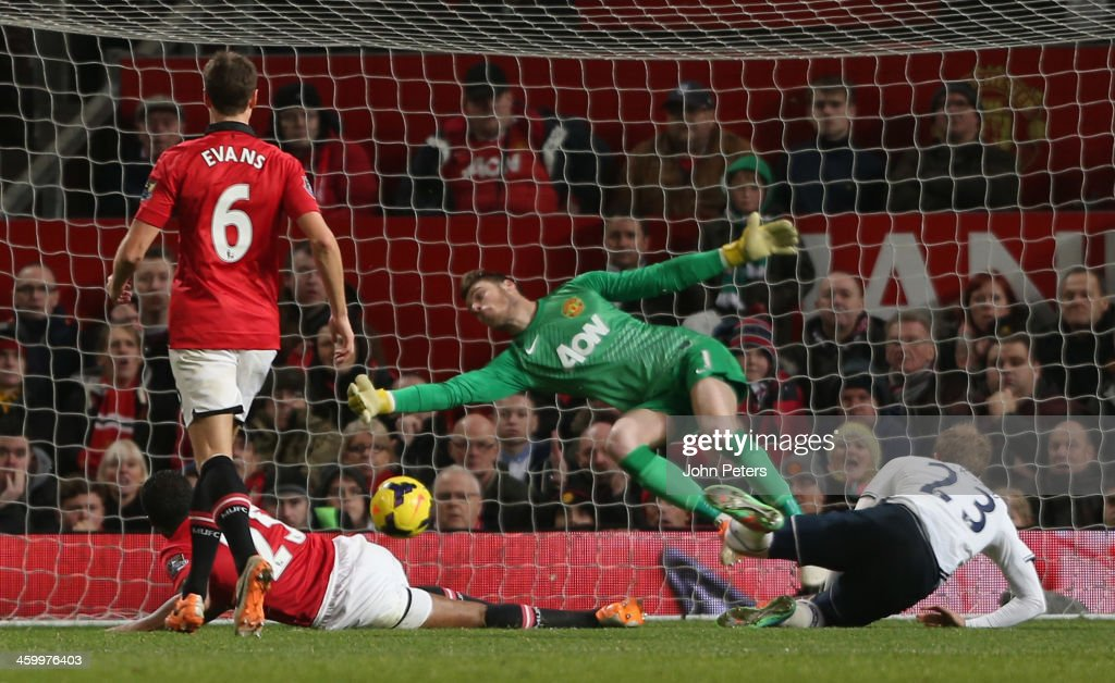 Christian Eriksen of Tottenham Hotspur scores their second goal during the Barclays Premier League match between Manchester United and Tottenham Hotspur at Old Trafford on January 1, 2014 in Manchester, England.