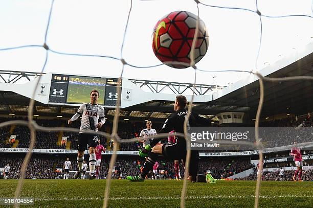 Christian Eriksen of Tottenham Hotspur scores their third goal past goalkeeper Artur Boruc of Bournemouth during the Barclays Premier League match...