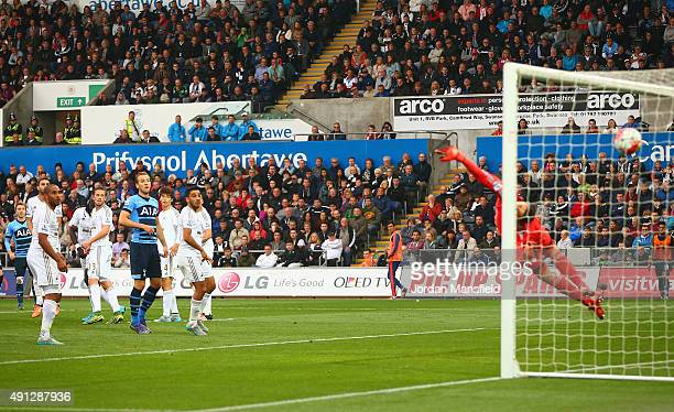 Christian Eriksen of Tottenham Hotspur scores Tottenham's second goal during the Barclays Premier League match between Swansea City and Tottenham...