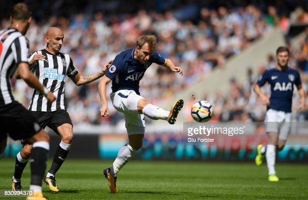 Christian Eriksen of Tottenham Hotspur shoots during the Premier League match between Newcastle United and Tottenham Hotspur at St James Park on...