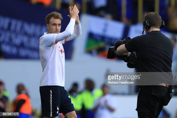 Christian Eriksen of Tottenham Hotspur shows appreciation to the fans while warming up prior to the Premier League match between Tottenham Hotspur...