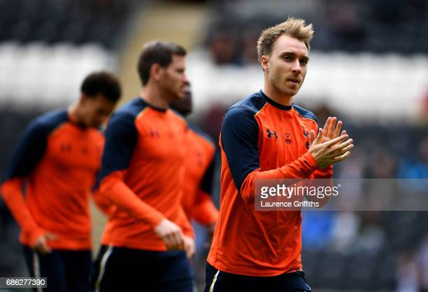 Christian Eriksen of Tottenham Hotspur shows appreciation to the fans as he warms up prior to the Premier League match between Hull City and...