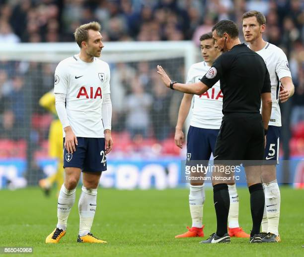 Christian Eriksen of Tottenham Hotspur speaks to the referee Andre Marriner during the Premier League match between Tottenham Hotspur and Liverpool...