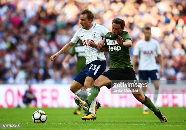 Christian Eriksen of Tottenham Hotspur tackles with Claudio Marchisio of Jeventus during the PreSeason Friendly match beween Tottenham Hotspur and...