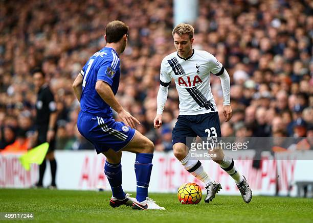 Christian Eriksen of Tottenham Hotspur takes on Branislav Ivanovic of Chelsea during the Barclays Premier League match between Tottenham Hotspur and...