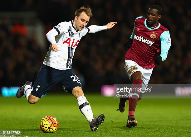 Christian Eriksen of Tottenham Hotspur takes on Pedro Mba Obiang of West Ham United during the Barclays Premier League match between West Ham United...
