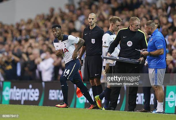 Christian Eriksen of Tottenham is substituted for Georges Kevin Nkoudou during the EFL Cup Third Round match between Tottenham Hotspur and Gillingham...