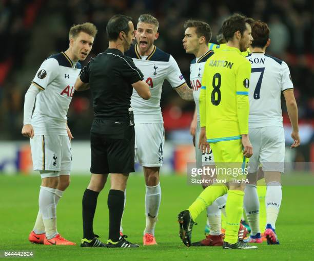 Christian Eriksen Toby Alderweireld and Harry Winks of Tottenham Hotspur react towards referee Manuel De Sousa during the UEFA Europa League Round of...