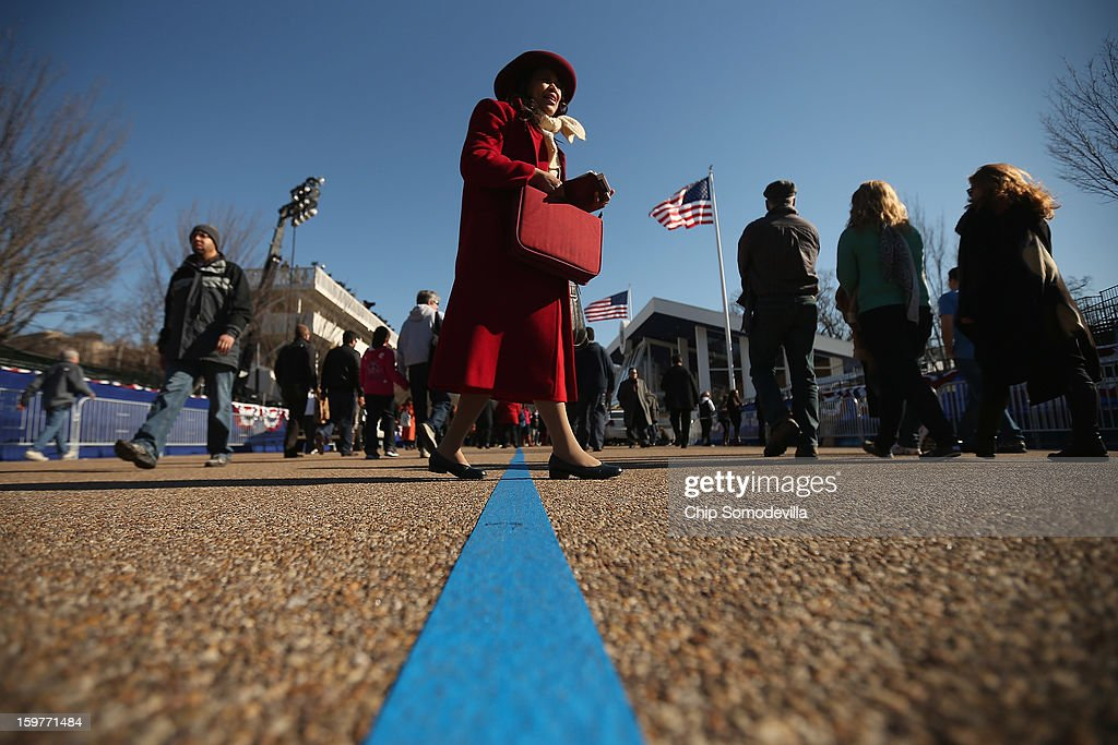 Christian evangelist Mary Clement of Silver Spring, Maryland, sings and reads from her Bible as she walks along Pennsylvania Avenue outside the White House as U.S. President Barack Obama takes the Oath of Office inside January 20, 2013 in Washington, DC. One day before the public inaugural ceremony at the U.S. Capitol, Obama was officially sworn in for his second term during a private ceremony surrounded by friends and family in the Blue Room of the White House.