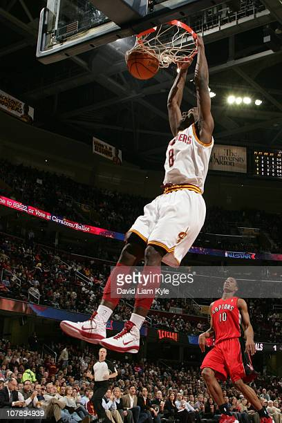 Christian Eyenga of the Cleveland Cavaliers dunks against DeMar DeRozan of the Toronto Raptors during the game at The Quicken Loans Arena on January...
