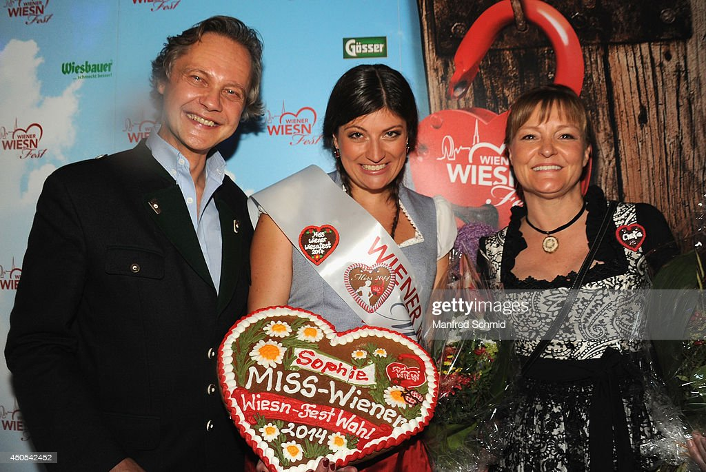 Christian Feldhofer, Sophie Marie winner of 'Miss Wiener Wiesn-Fest 2014' and Claudia Wiesner pose for a photograph during the beauty competition 'Miss Wiener Wiesn-Fest 2014' at Platzhirsch on on June 12, 2014 in Vienna, Austria.