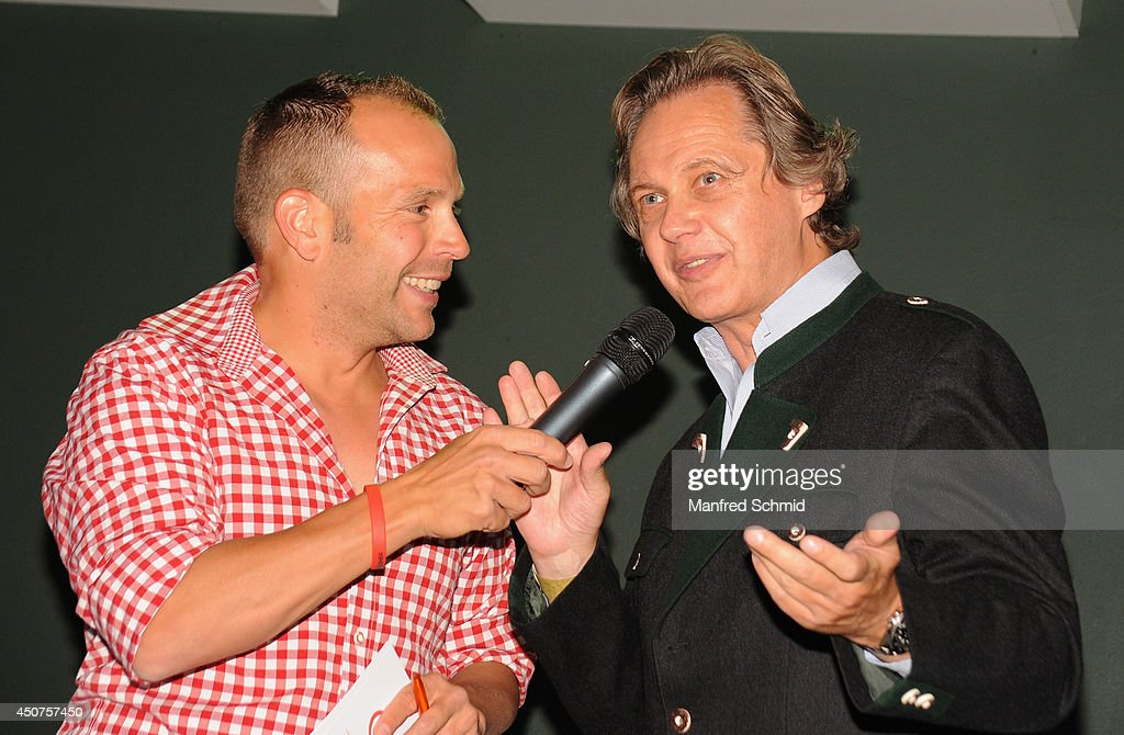 Christian Feldhofer (R) speaks to the audience during the beauty competition 'Miss Wiener Wiesn-Fest 2014' at Platzhirsch on on June 12, 2014 in Vienna, Austria.