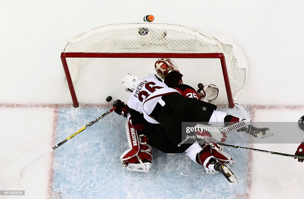 Christian Fischer #36 of the Arizona Coyotes scores a goal prior to running into Cory Schneider #35 of the New Jersey Devils during the game at Prudential Center on October 28, 2017 in Newark, New Jersey.