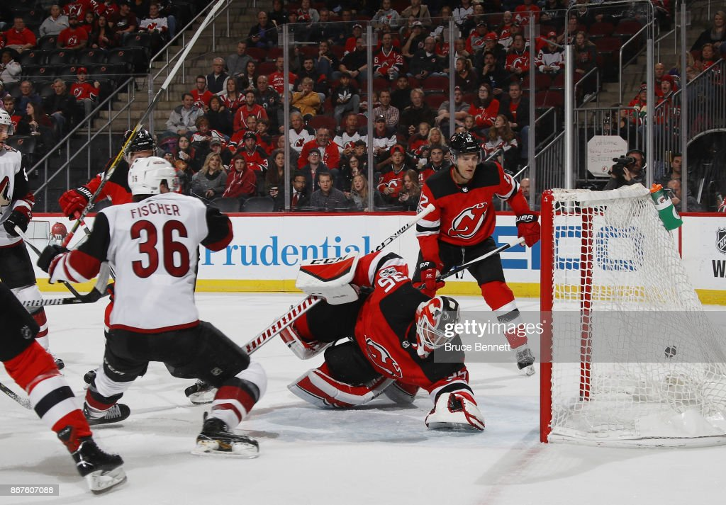 Christian Fischer #36 of the Arizona Coyotes scores on the powerplay at 10:37 of the first period against Cory Schneider #35 of the New Jersey Devils at the Prudential Center on October 28, 2017 in Newark, New Jersey.