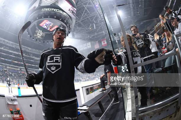 Christian Folin of the Los Angeles Kings highfives a young fan before a game against the Winnipeg Jets at STAPLES Center on November 22 2017 in Los...