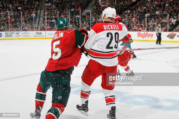 Christian Folin of the Minnesota Wild and Bryan Bickell of the Carolina Hurricanes collide during the game on April 4 2017 at the Xcel Energy Center...