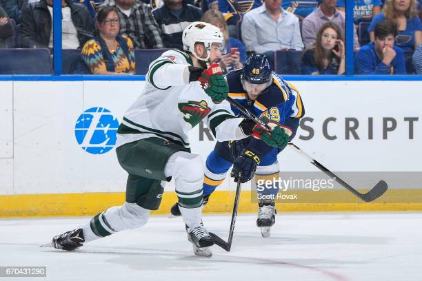 Christian Folin of the Minnesota Wild makes a pass as Ivan Barbashev of the St Louis Blues pressures in Game Four of the Western Conference First...