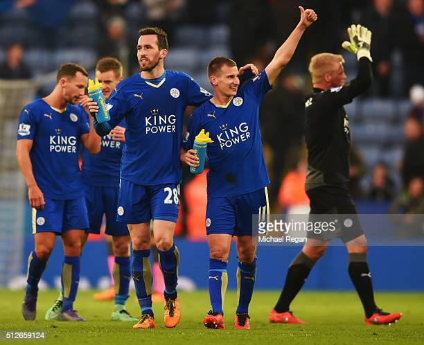 Christian Fuchs and Marc Albrighton of Leicester City celebrate their 10 win after the Barclays Premier League match between Leicester City and...