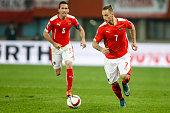 Christian Fuchs and Marko Arnautovic of Austria in action during the UEFA EURO 2016 Qualifier between Austria and Liechtenstein at Ernst Happel...
