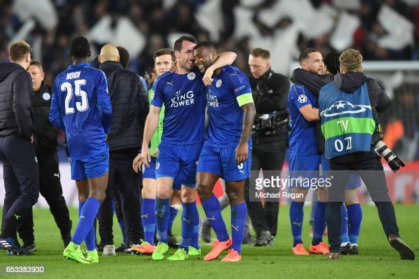 Christian Fuchs and Wes Morgan of Leicester City celebrate their team's 32 agg victory during the UEFA Champions League Round of 16 second leg match...