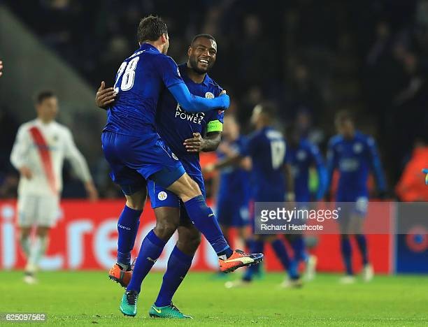 Christian Fuchs and Wes Morgan of Leicester City celebrate victory after the full time whistle in the UEFA Champions League match between Leicester...
