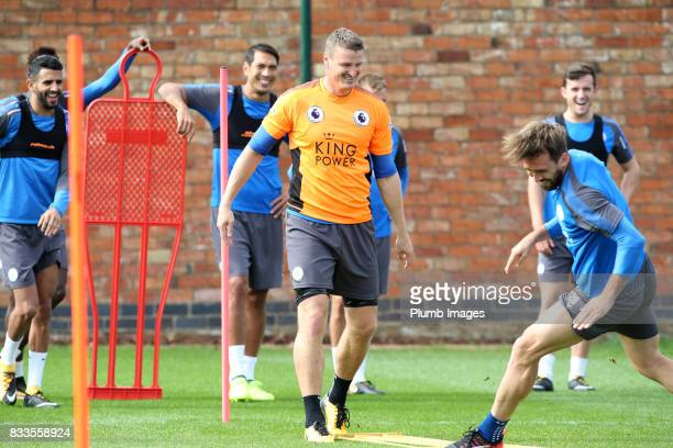 Christian Fuchs collides with Robert Huth during the Leicester City training session at Belvoir Drive Training Complex on August 17 2017 in Leicester...