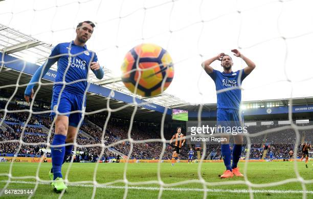 Christian Fuchs of Leicester City and Danny Drinkwater of Leicester City reacts to Hull City scoring their first goal during the Premier League match...