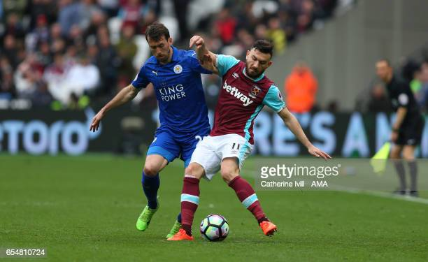 Christian Fuchs of Leicester City and Robert Snodgrass of West Ham during the Premier League match between West Ham United and Leicester City at...