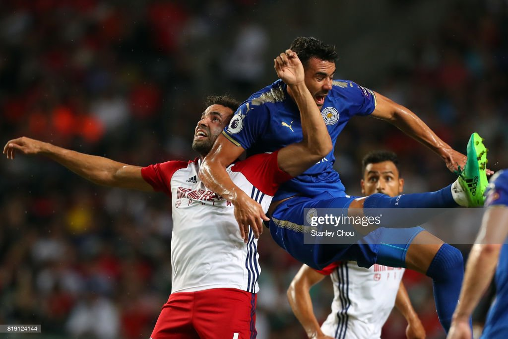 Christian Fuchs of Leicester City battles with Hal Robson-Kanu of West Bromwich Albion during the Premier League Asia Trophy match between Leicester City and West Bromwich Albion at Hong Kong Stadium on July 19, 2017 in Hong Kong, Hong Kong.