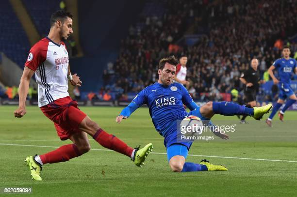 Christian Fuchs of Leicester City cuts out a cross from Grzegorz Krychowiak of West Bromwich Albion during the Premier League match between Leicester...