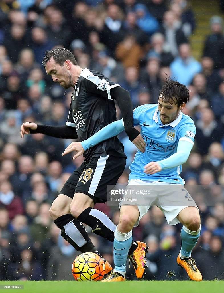 Christian Fuchs of Leicester City in action with David Silva of Manchester City during the Premier League match between Manchester City and Leicester City at Etihad Stadium on February 6, 2016 in Manchester, United Kingdom.