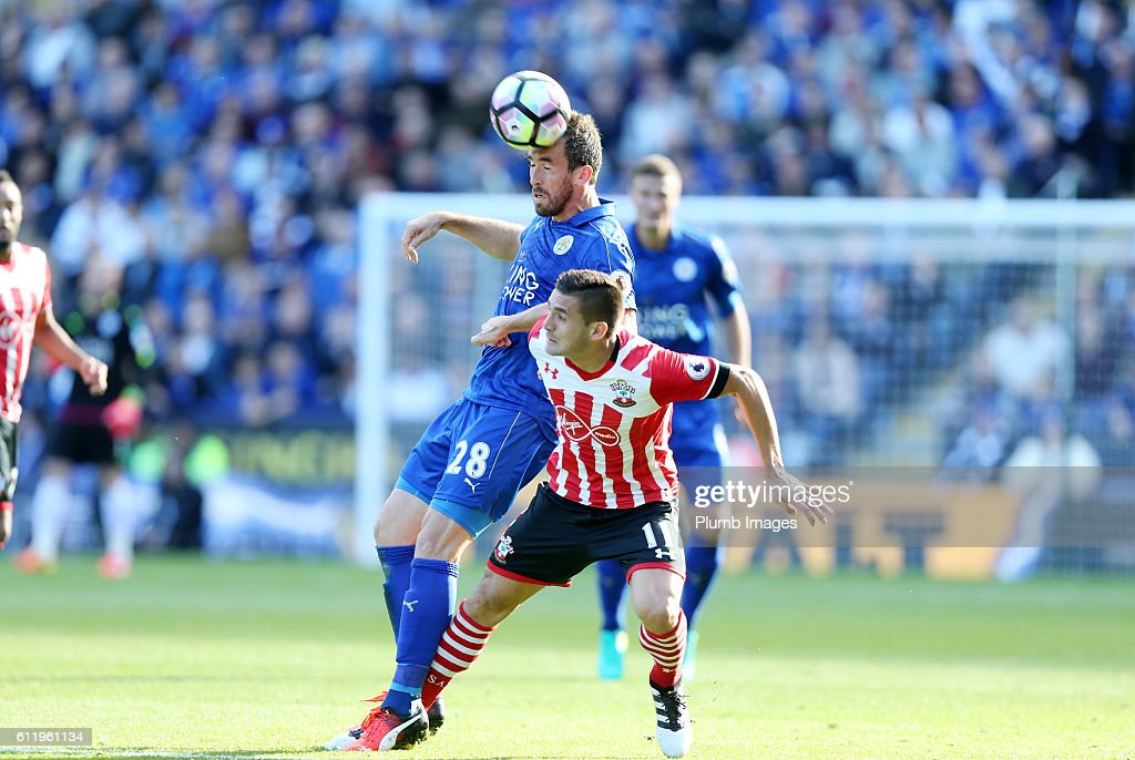Christian Fuchs of Leicester City in action with Dusan Tadic of Southampton during the Barclays Premier League match between Leicester City and Southampton at the King Power Stadium on October 2nd , 2016 in Leicester, United Kingdom.