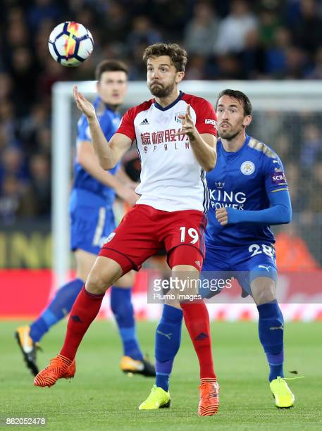 Christian Fuchs of Leicester City in action with Jay Rodriguez of West Bromwich Albion during the Premier League match between Leicester City and...