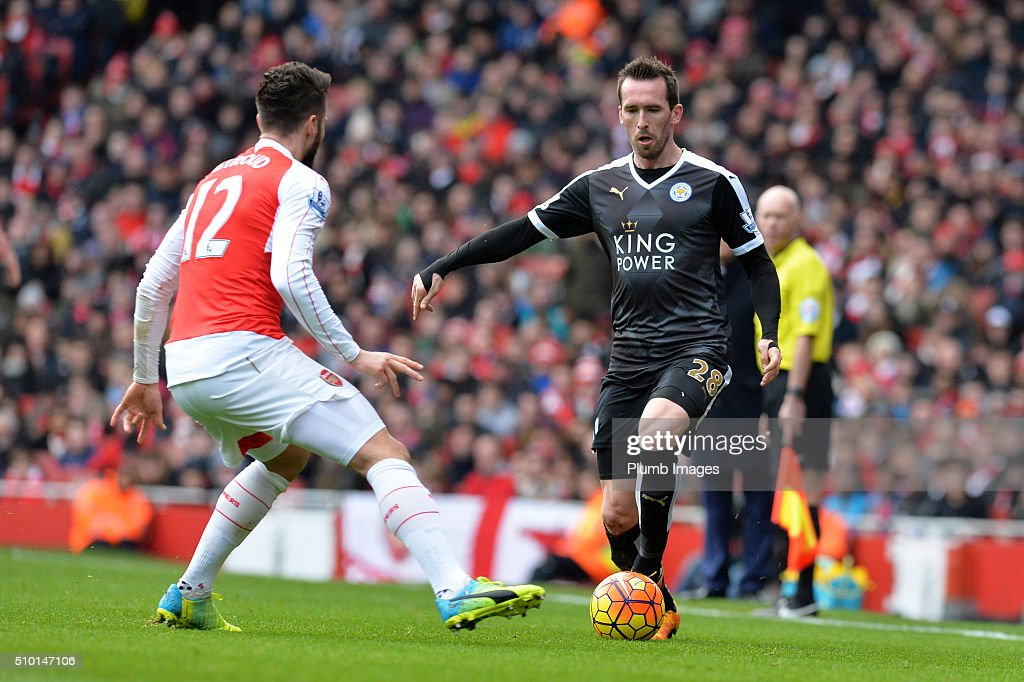 Christian Fuchs of Leicester City in action with Olivier Giroud of Arsenal during the Premier League match between Arsenal and Leicester City at Emirates Stadium on February 14, 2016 in London, United Kingdom.
