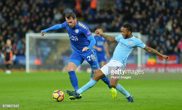 Christian Fuchs of Leicester City in action with Raheem Sterling of Manchester City during the Premier League match between Leicester City and...