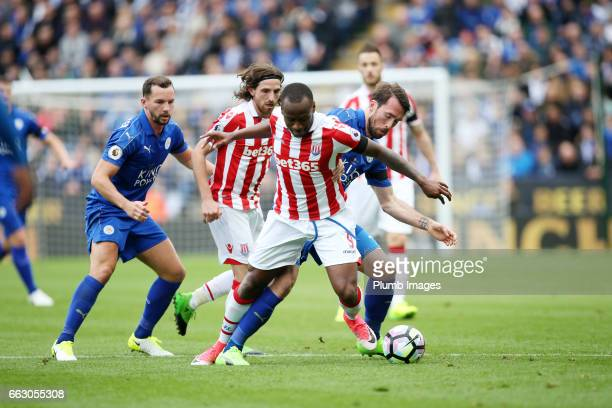 Christian Fuchs of Leicester City in action with Saido Berahino of Stoke City during the Premier League match between Leicester City and Stoke City...