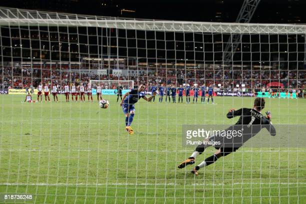 Christian Fuchs of Leicester City scores from the penalty spot during the Premier League Asia Trophy match between Leicester City and West Bromwich...