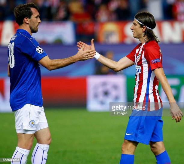Christian Fuchs of Leicester City shakes hands with Filipe Luis of Atletico Madrid during the UEFA Champions League Quarter Final first leg match...