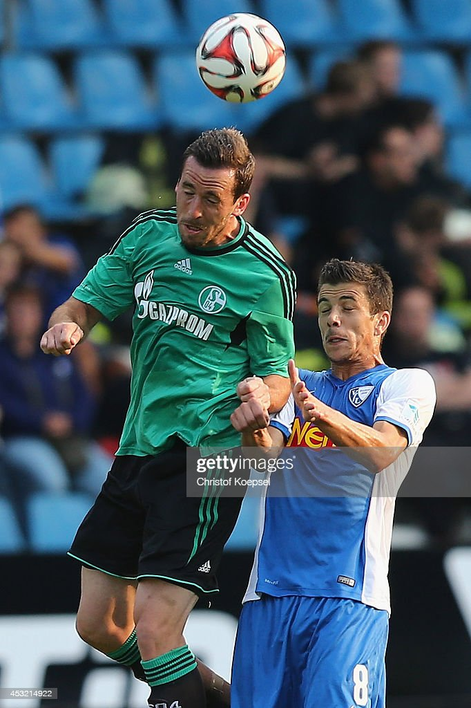 Christian Fuchs of Schalke and Anthony Losilla of Bochum go up for a header during the pre-season friendly match between VfL Bochum and FC Schalke 04 at Rewirpower Stadium on August 5, 2014 in Bochum, Germany.
