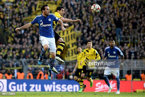 Christian Fuchs of Schalke and Henrikh Mkhitaryan of Dortmund jump for a header during the Bundesliga match between Borussia Dortmund and FC Schalke...