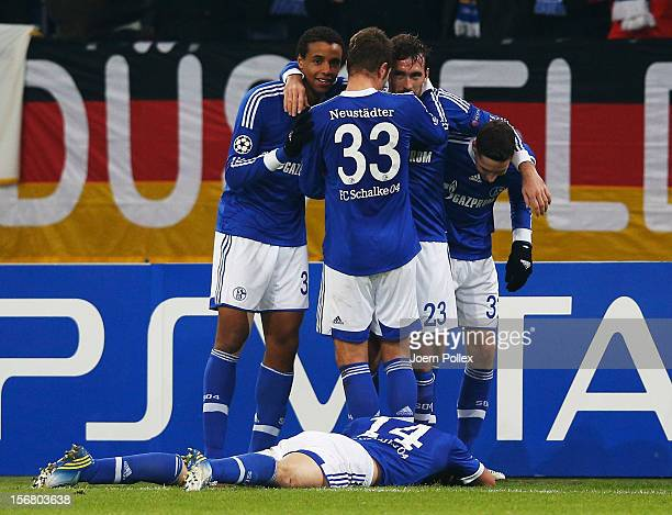 Christian Fuchs of Schalke celebrates with his team mates after scoring his team's first goal during the UEFA Champions League group B match between...