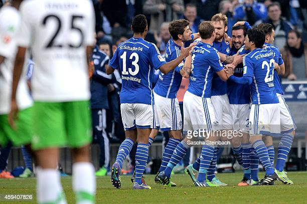 Christian Fuchs of Schalke celebrates with team mates after soring his team's thrid goal during the Bundesliga match between FC Schalke 04 and VfL...