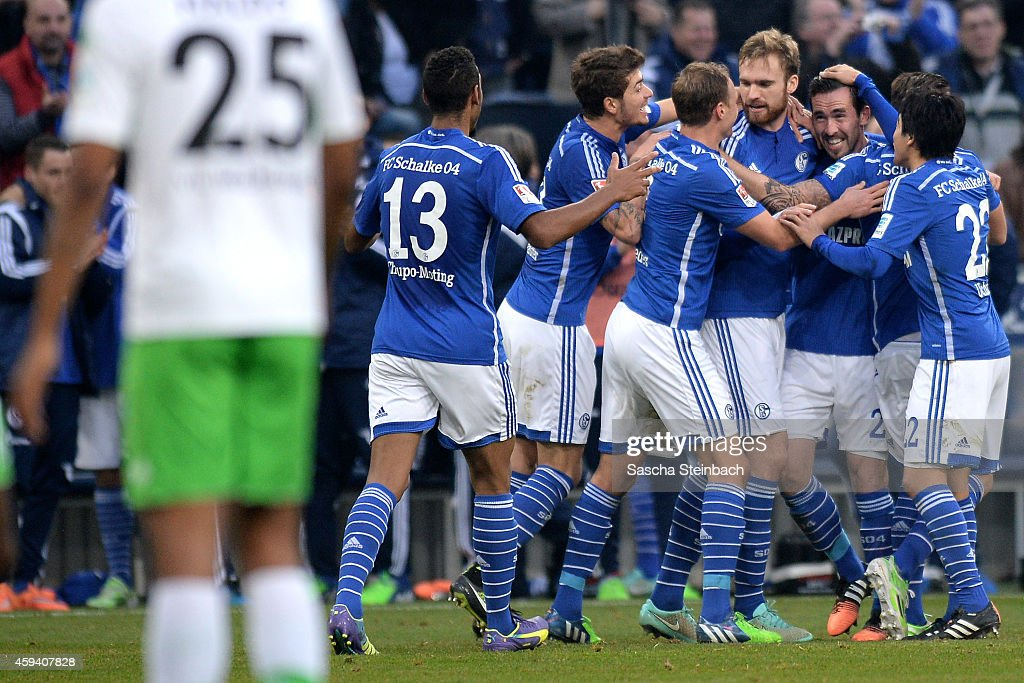 <a gi-track='captionPersonalityLinkClicked' href=/galleries/search?phrase=Christian+Fuchs&family=editorial&specificpeople=4143238 ng-click='$event.stopPropagation()'>Christian Fuchs</a> (2-R) of Schalke celebrates with team mates after soring his team's thrid goal during the Bundesliga match between FC Schalke 04 and VfL Wolfsburg at Veltins Arena on November 22, 2014 in Gelsenkirchen, Germany.