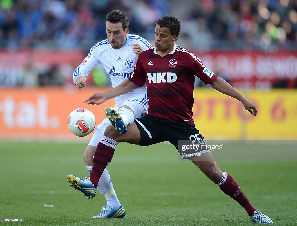 Christian Fuchs (L) of Schalke challenges Timothy Chandler of Nuernberg during the Bundesliga match between 1. FC Nuernberg and FC Schalke 04 at Grundig-Stadion on March 16, 2013 in Nuremberg, Germany.