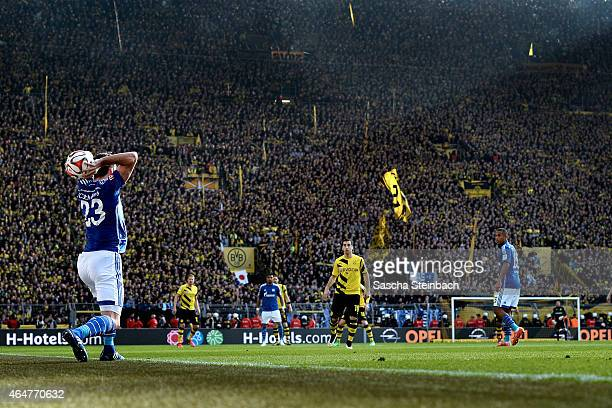 Christian Fuchs of Schalke throws the ball during the Bundesliga match between Borussia Dortmund and FC Schalke 04 at Signal Iduna Park on February...