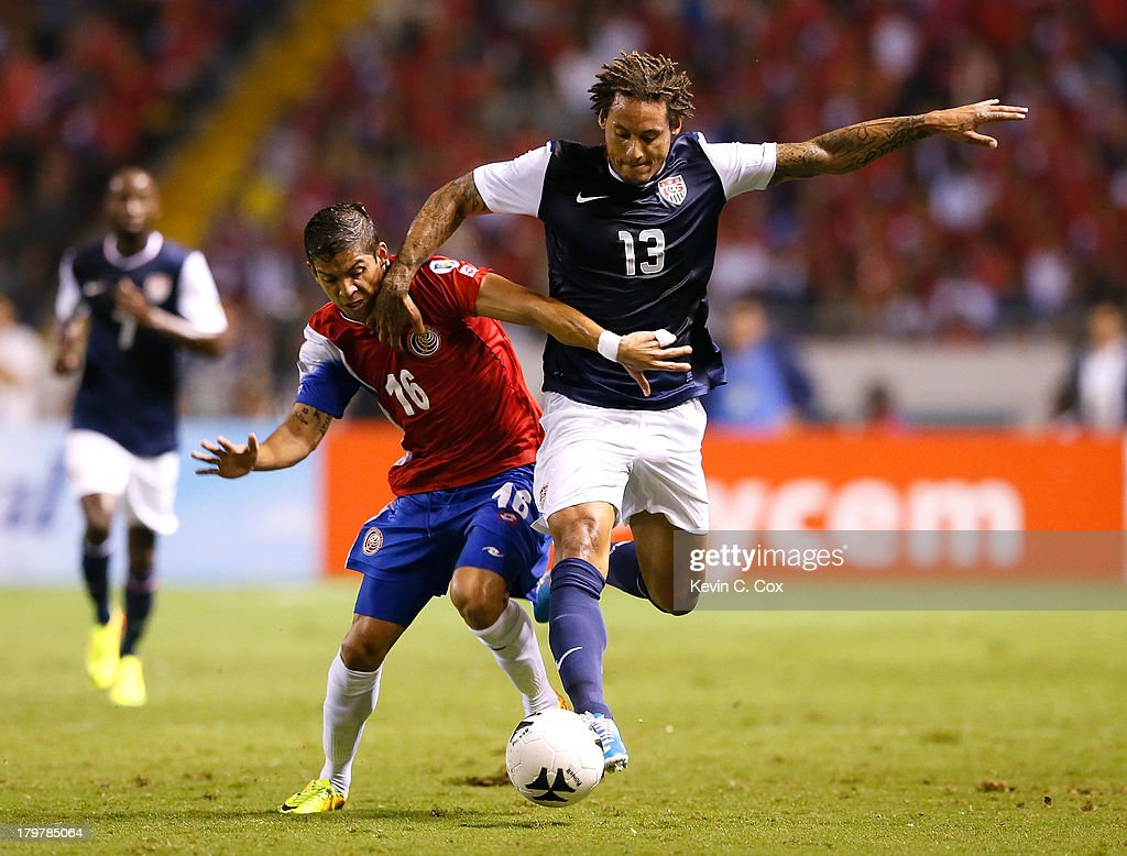 Christian Gamboa #16 and <a gi-track='captionPersonalityLinkClicked' href=/galleries/search?phrase=Jermaine+Jones+-+Soccer+Player&family=editorial&specificpeople=12906336 ng-click='$event.stopPropagation()'>Jermaine Jones</a> #13 of the United States battle during the FIFA 2014 World Cup Qualifier at Estadio Nacional on September 6, 2013 in San Jose, Costa Rica.