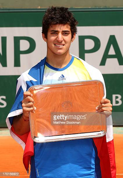 Christian Garin of Chile celebrates poses with the trophy after victoryin his boys' singles final match against Alexander Zverev of Germany during...