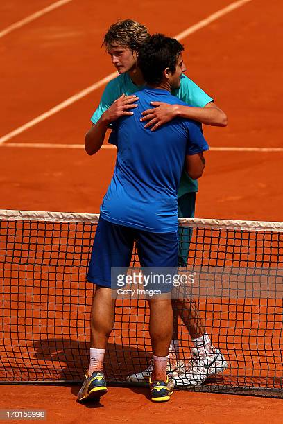 Christian Garin of Chile hugs Alexander Zverev of Germany at the net after the boys' singles final match during day fourteen of French Open at Roland...